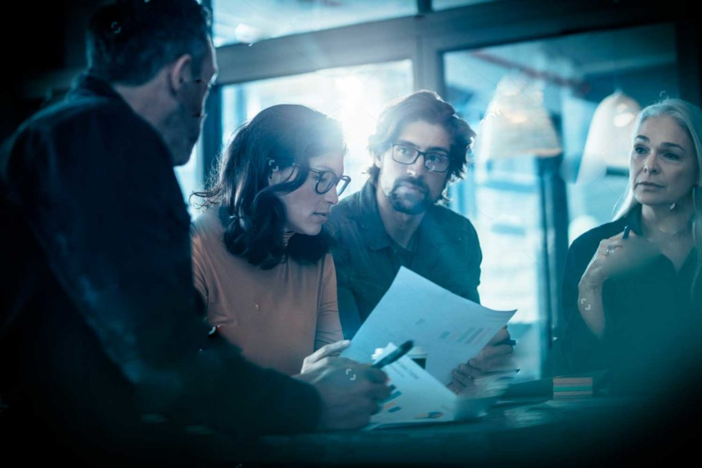 stock-photo-business-people-discussing-over-new-business-project-in-office-team-brainstorming-for-new-business-1168692604